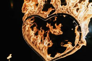 heart shaped firework on black background, fire show in night